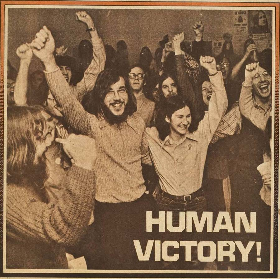 "A picture of youth celebrating with text in the lower left corner reading, ""Human Victory"""