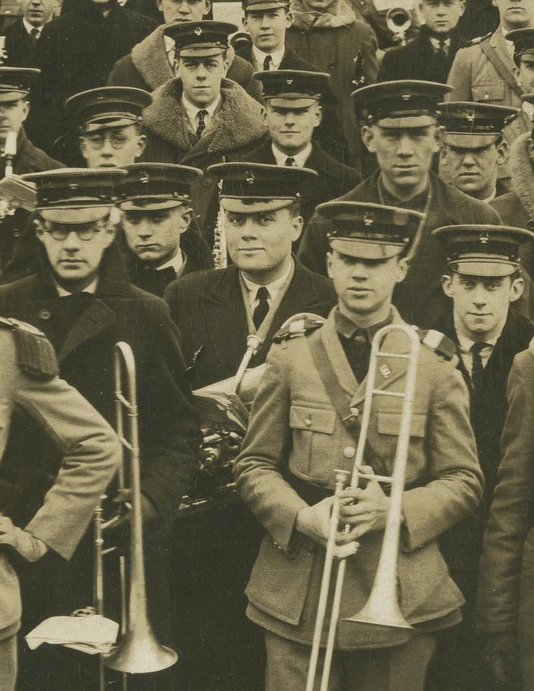 Detail of Herman B Wells in Marching Hundred, wearing uniform and holding baritone horn