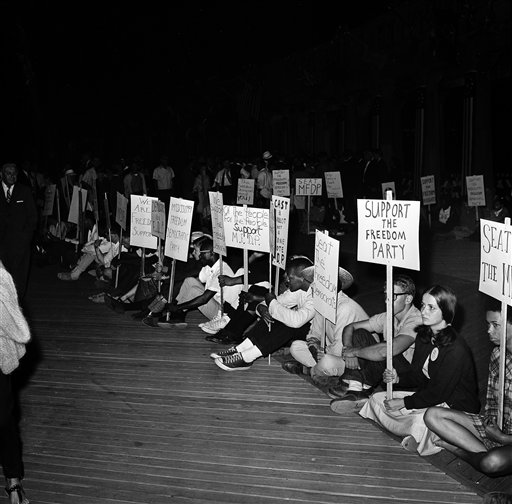 Demonstrators advocating for the Freedom Democratic Party sit outside the Democratic Convention Hall on August 24, 1964