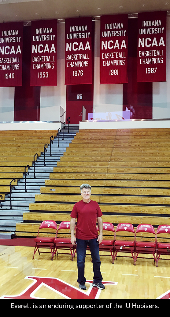 Photo of Everett Kunzelman standing in Assembly Hall