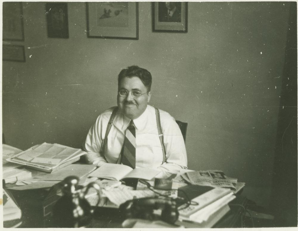 Herman B Wells sitting at desk, circa 1936