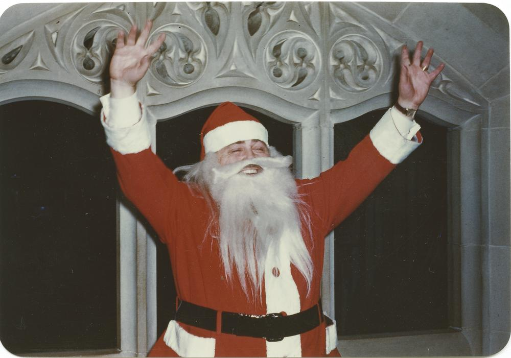 Color photograph of Herman B Wells in a Santa Claus suit and beard