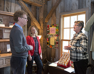 Sherry Wise, Dr. Fowler and Carey Beam view the seed library.