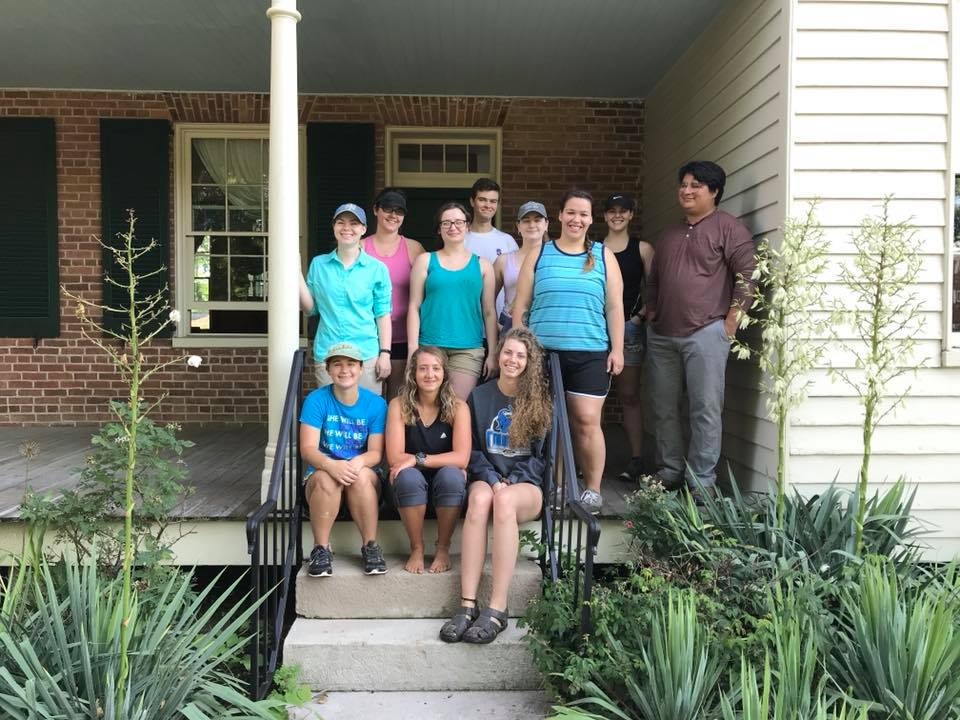 Archaeology field school students on front porch of museum