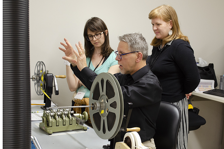 BAVASS attendees learning from an expert with film equipment