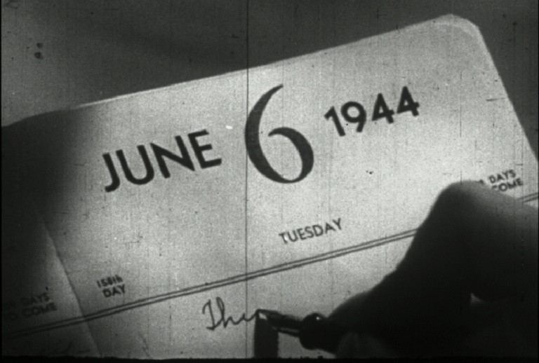 Still from a WWII film showing calendar dated June 6 1944
