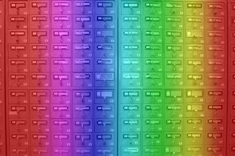 Library card catalog with rainbow colors superimposed