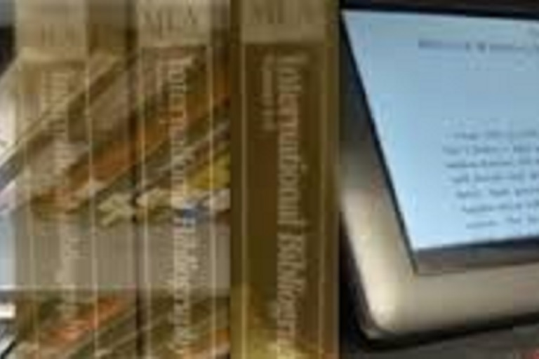 MLA Bibliography volumes and a tablet