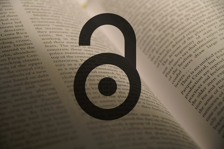 open access icon superimposed on pages of a book