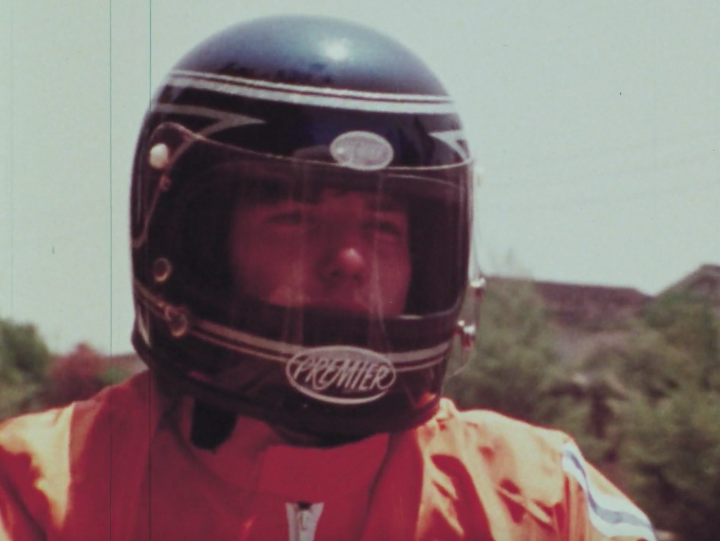 a motorcycle rider wearing a helmet
