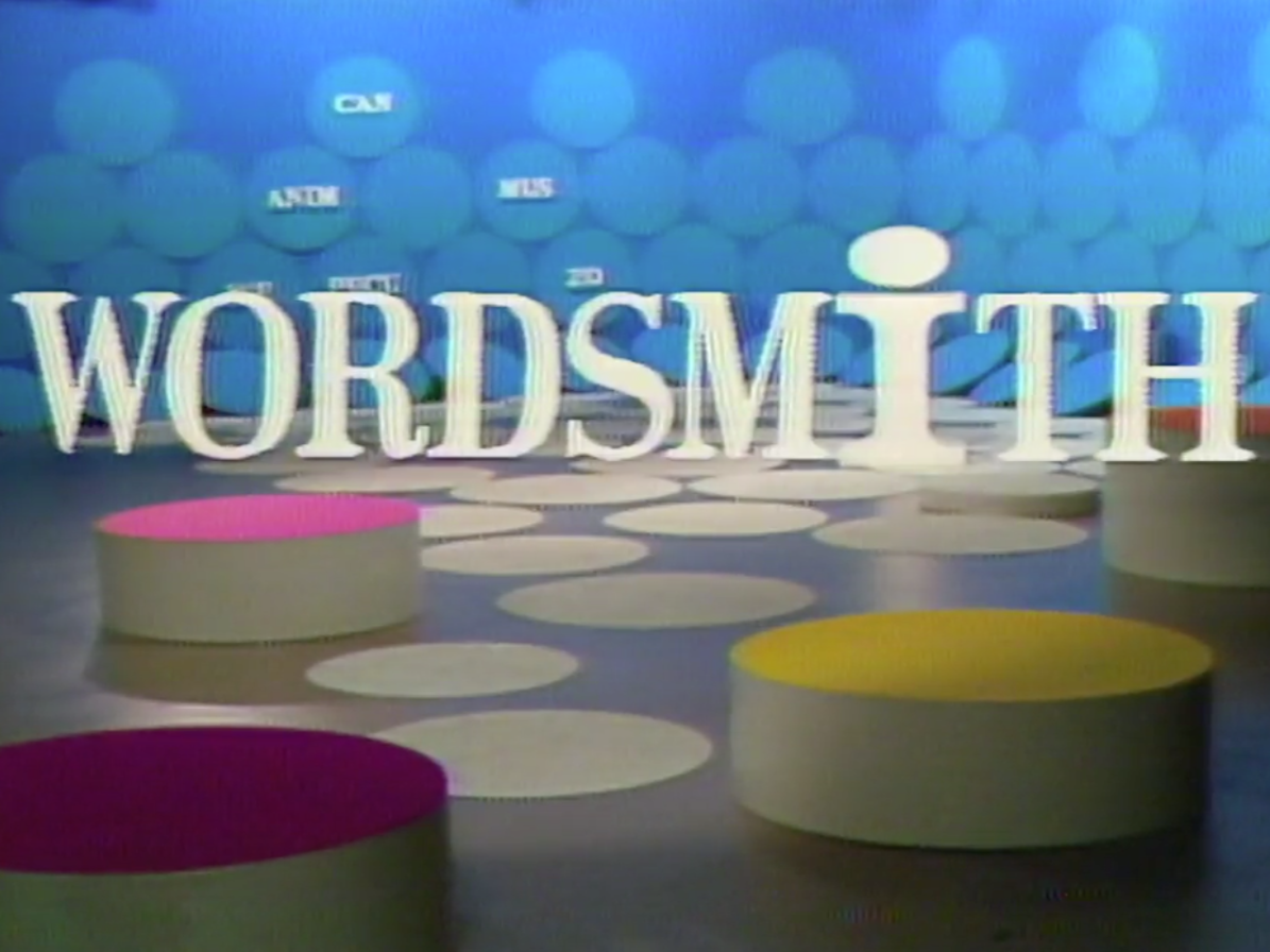 wordsmith title screen with colorful set and geometric shapes