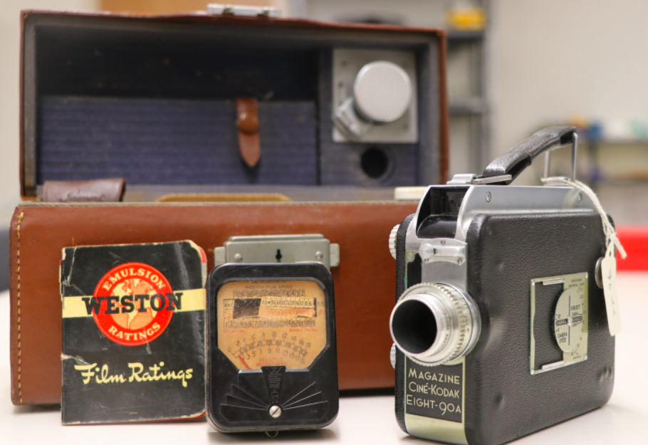 image shows antique camera and carrying case
