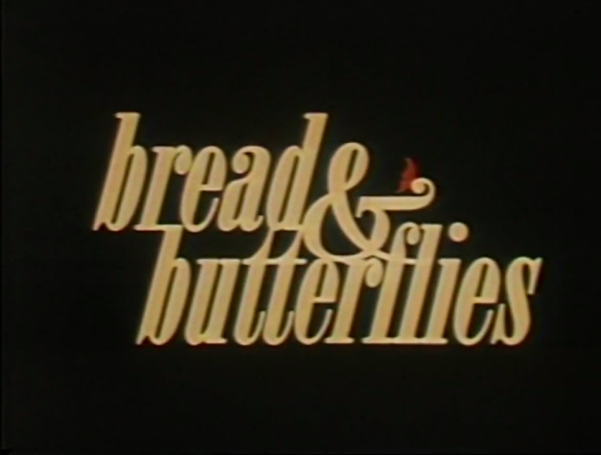 title screen for bread and butterflies with yellow lettering and a red butterfly