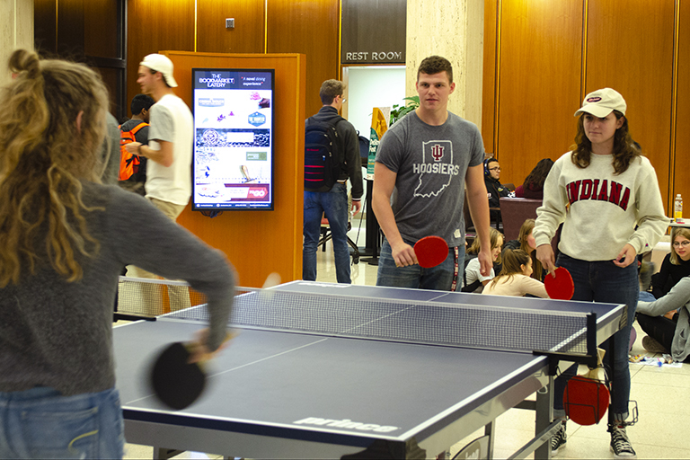 Students playing ping-pong at DeStress Fest