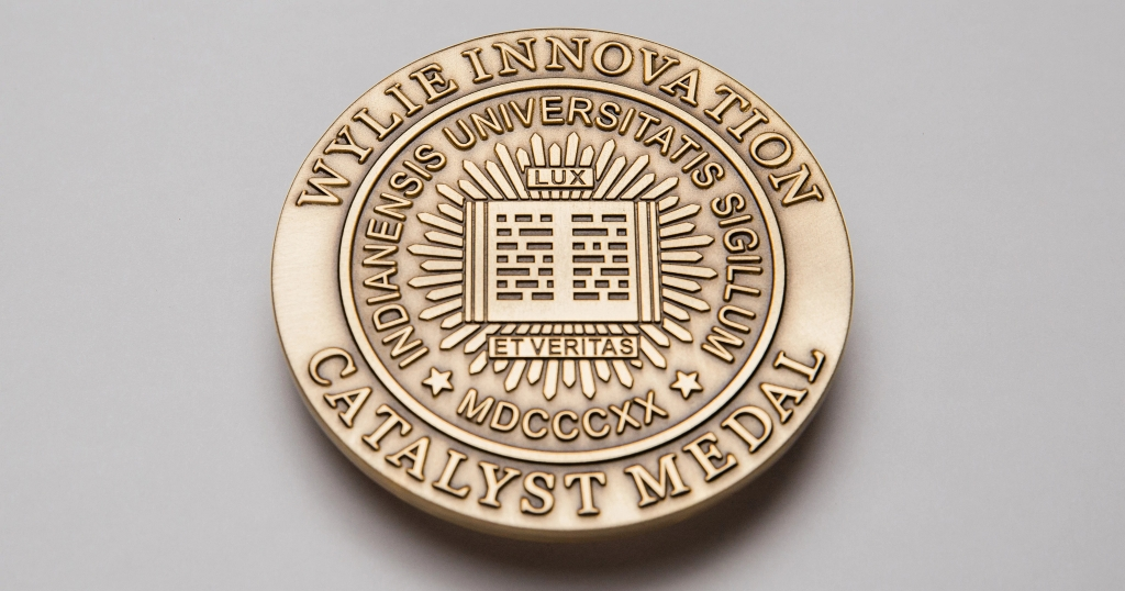 Bronze round medal inscribed with the words, Wylie Innovation Catalyst Medal
