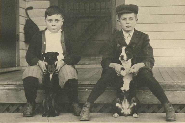 Herman B Wells (left) with Will Parker and Parker's two dogs