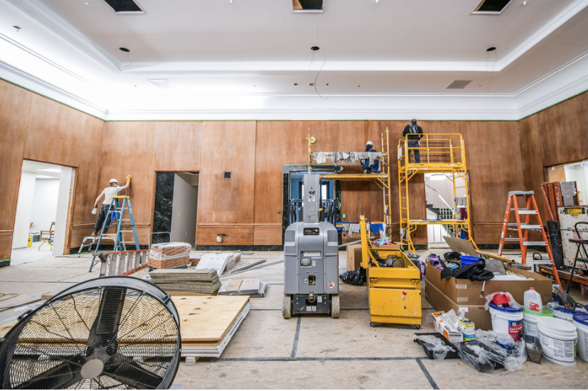 A photo shows the main gallery of the Lilly Library full of construction equipment