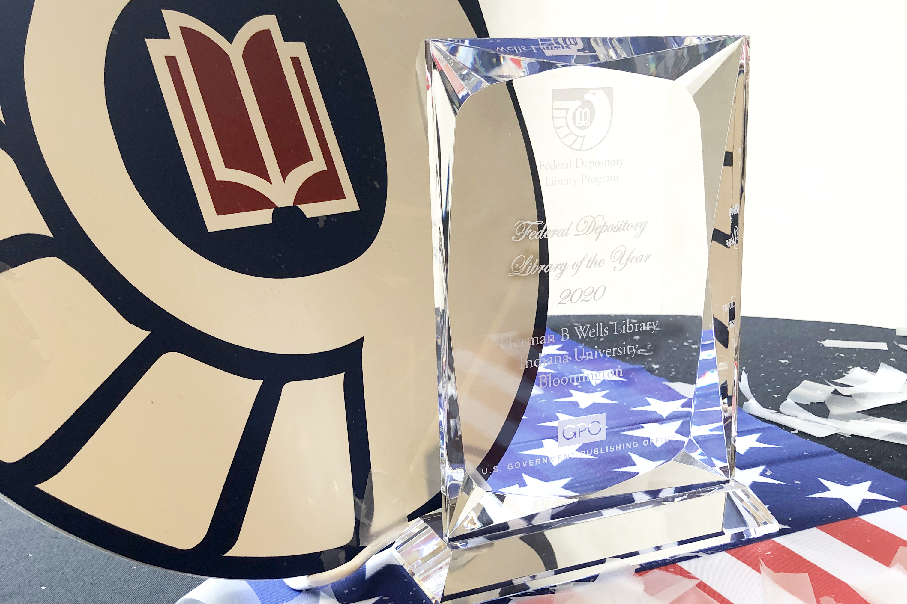 "A glass award is etched with the words ""Library of the Year"""