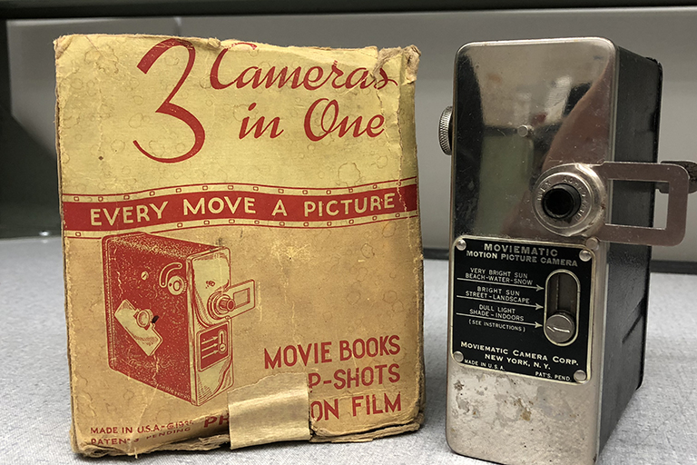 A photo of a 1930's 16mm camera with its original packaging