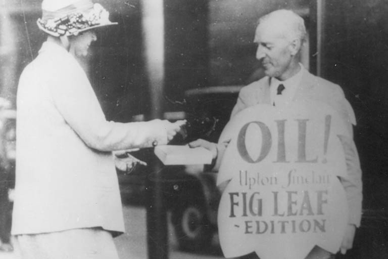 "Photograph of Upton Sinclair selling the ""fig-leaf"" edition of his novel, Oil!"