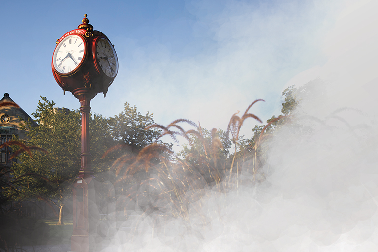 An iconic red clock is shown with a haze of smoke applied to the photo so it look like it is being erased by a fog