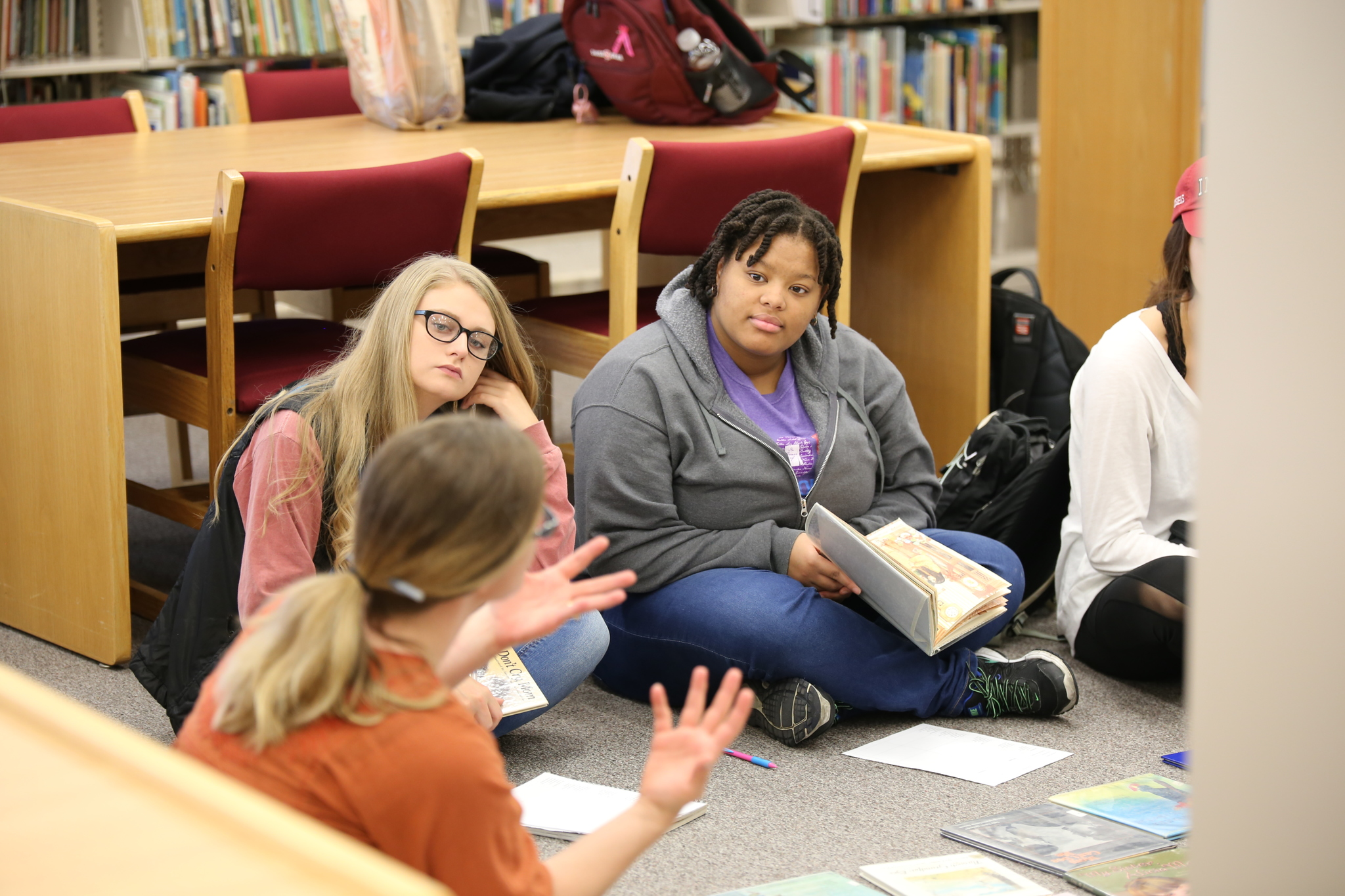 students and librarian discussing literature