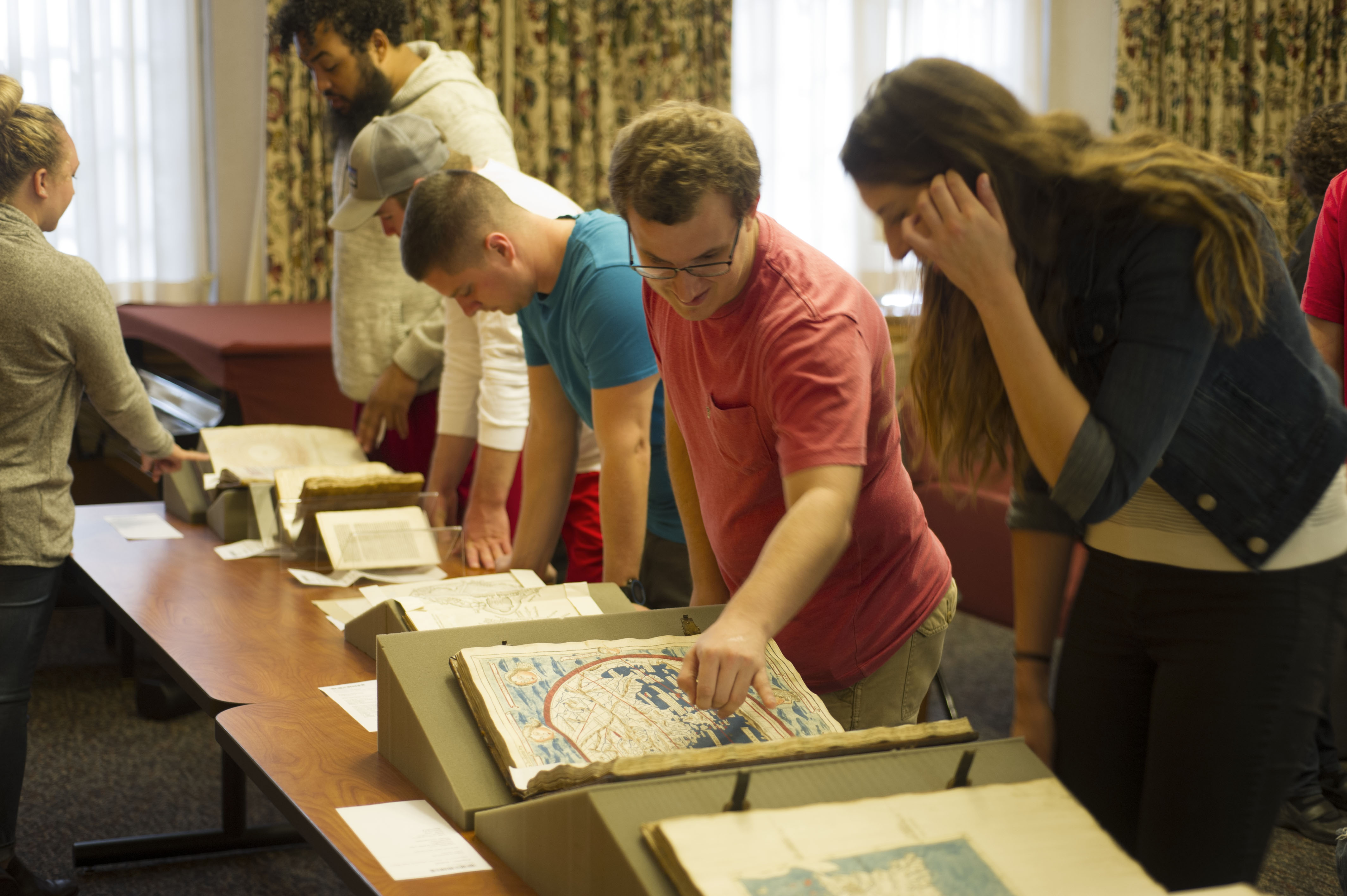 students examining rare books at the Lilly Library