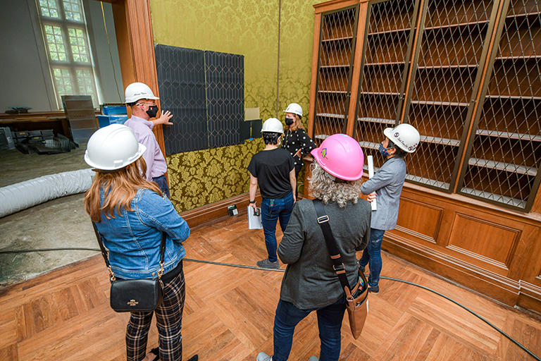 Libraries executive staff and IU architects/interior designers confer over textiles in the Lilly Library, summer 2020