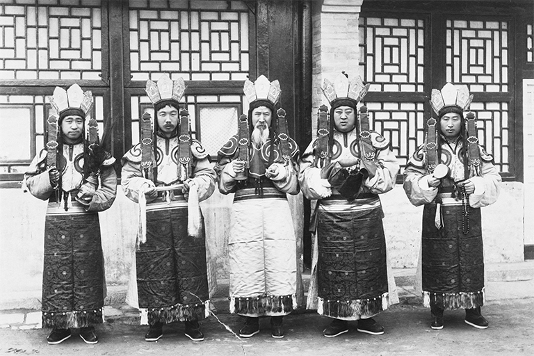"Photo from Berthold Laufer collection used by permission of the American Museum of Natural History (#336284). Titled ""Sacred dance of five lamas, China."" (ca 1901. – 1904)."