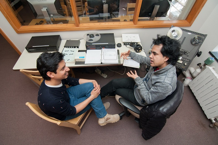 Graduate Assistant Suyash Kumar Neupane (left) helps research patron Shyam Nepali access recordings from the Annapurna Bech Memorial Collection.