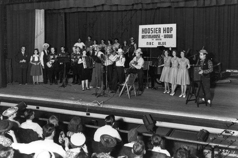 "The Black Hawk Valley Boys band performs on the stage for WOWO radio's 1940s ""Hoosier Hop"" radio show."