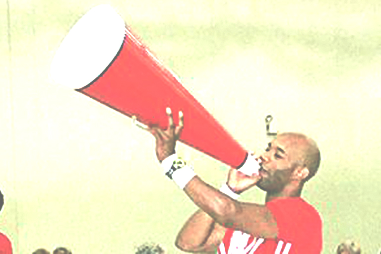 College-age black male is speaking into a large cheerleader megaphone