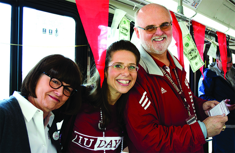 Picture of Carolyn Walters, Michelle Crowe and Chuck Crabb riding the A bus on IU Day.