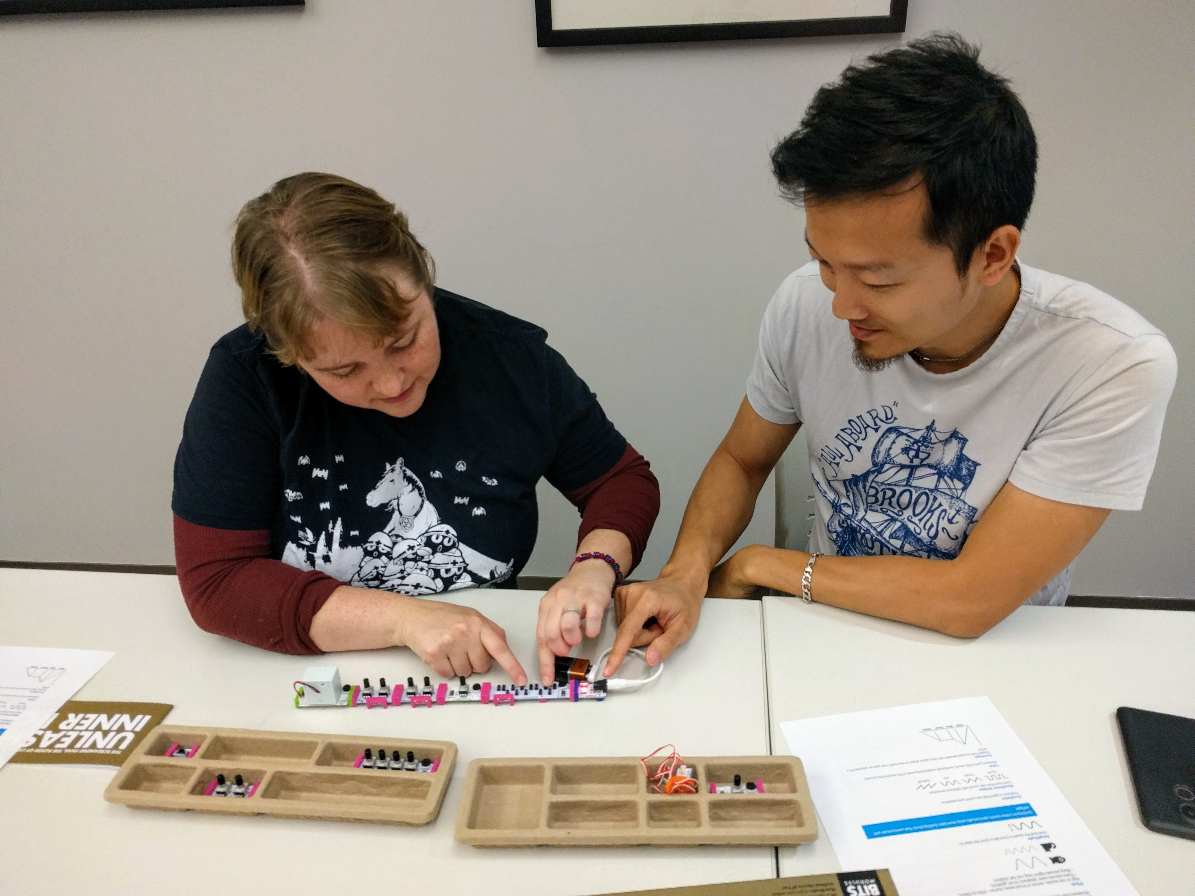 Two students play with littleBits synthesizer kits.