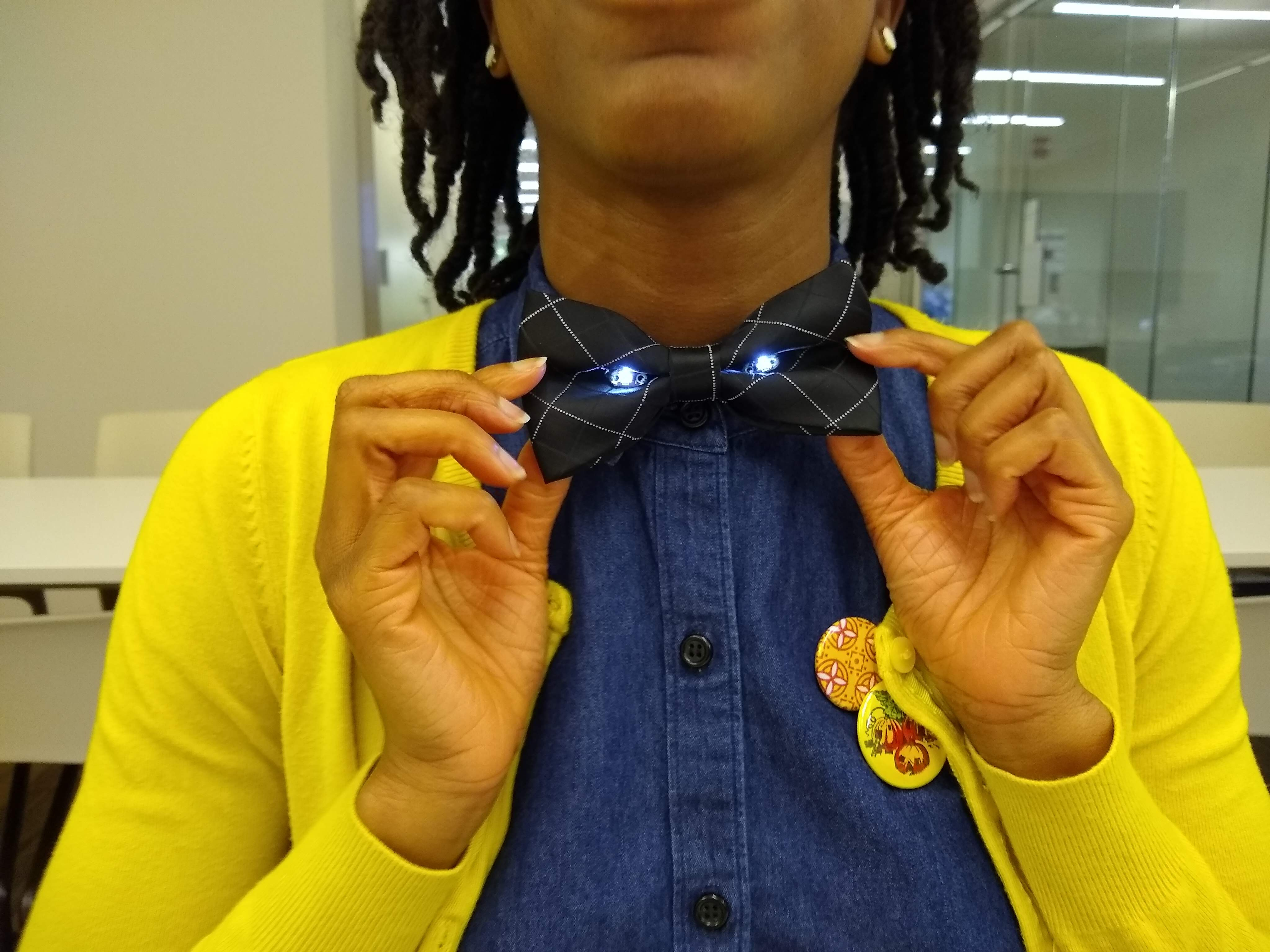 Woman wears a light up bow tie.