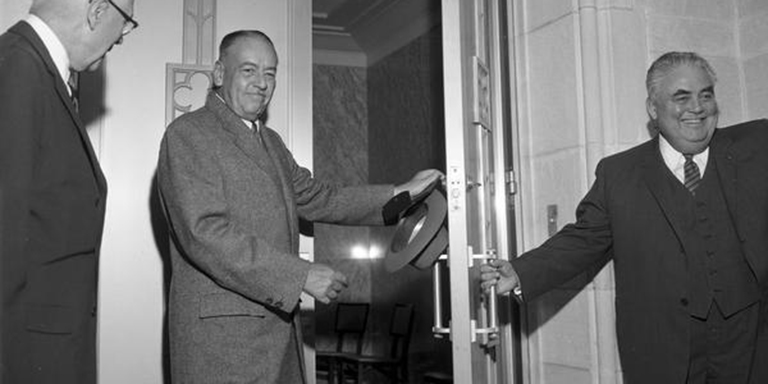 in a black-and-white photograph, three men open the door to the Lilly Library during its 1960 grand opening celebration