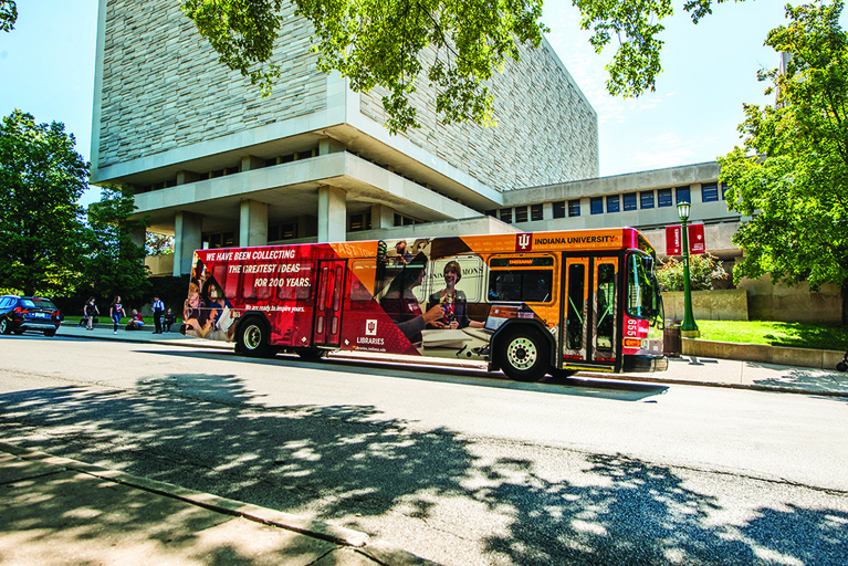 Image of IU campus bus parked in front of Wells Library