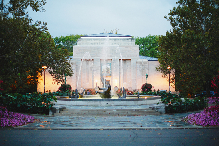 An exterior image of the Lilly Library in the early evening with the Showalter Fountain in the foreground
