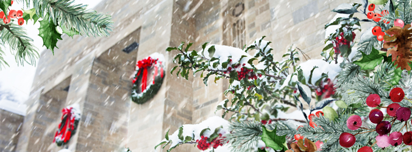 A festive frame of greenery is overlaid on a snowy image of the Lilly Library