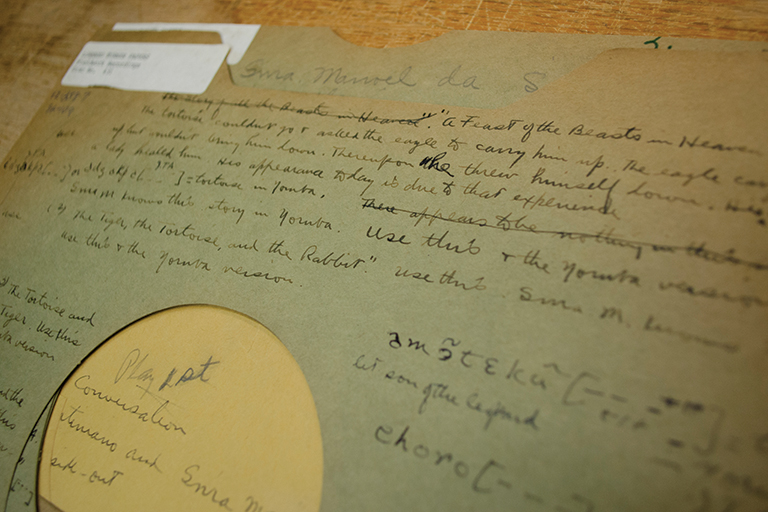 Handwritten notes are legible on a faded record sleeve