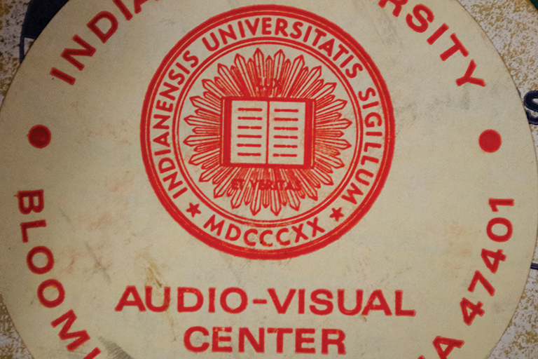 "The front of a vintage moving image film canister features the IU seal and the words ""Indiana University Audio-visual center"""