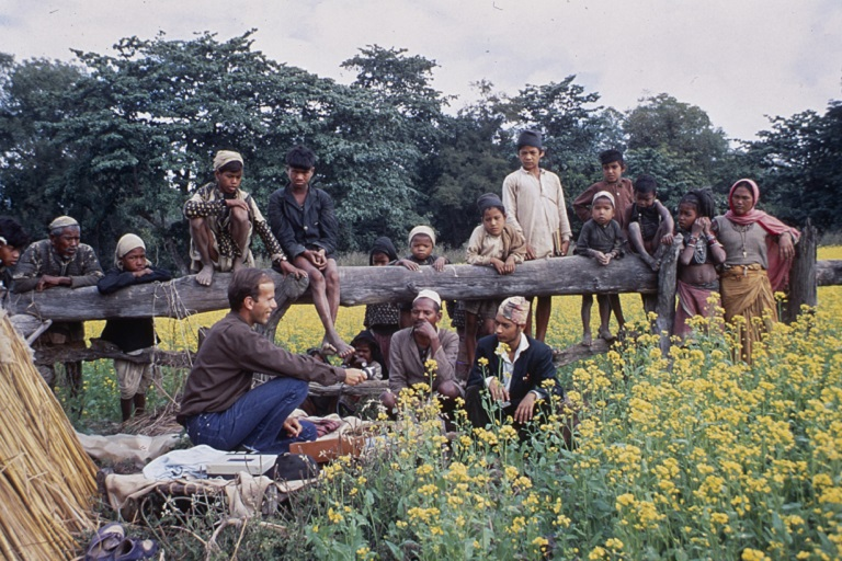 Terence Bech records members of Nepal's Rana Tharu culture group in a field in 1968.