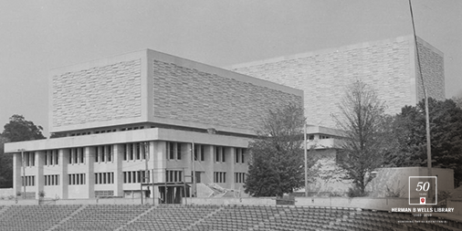 Exterior Photo of Wells Library in 1968 shows the old stadium seating