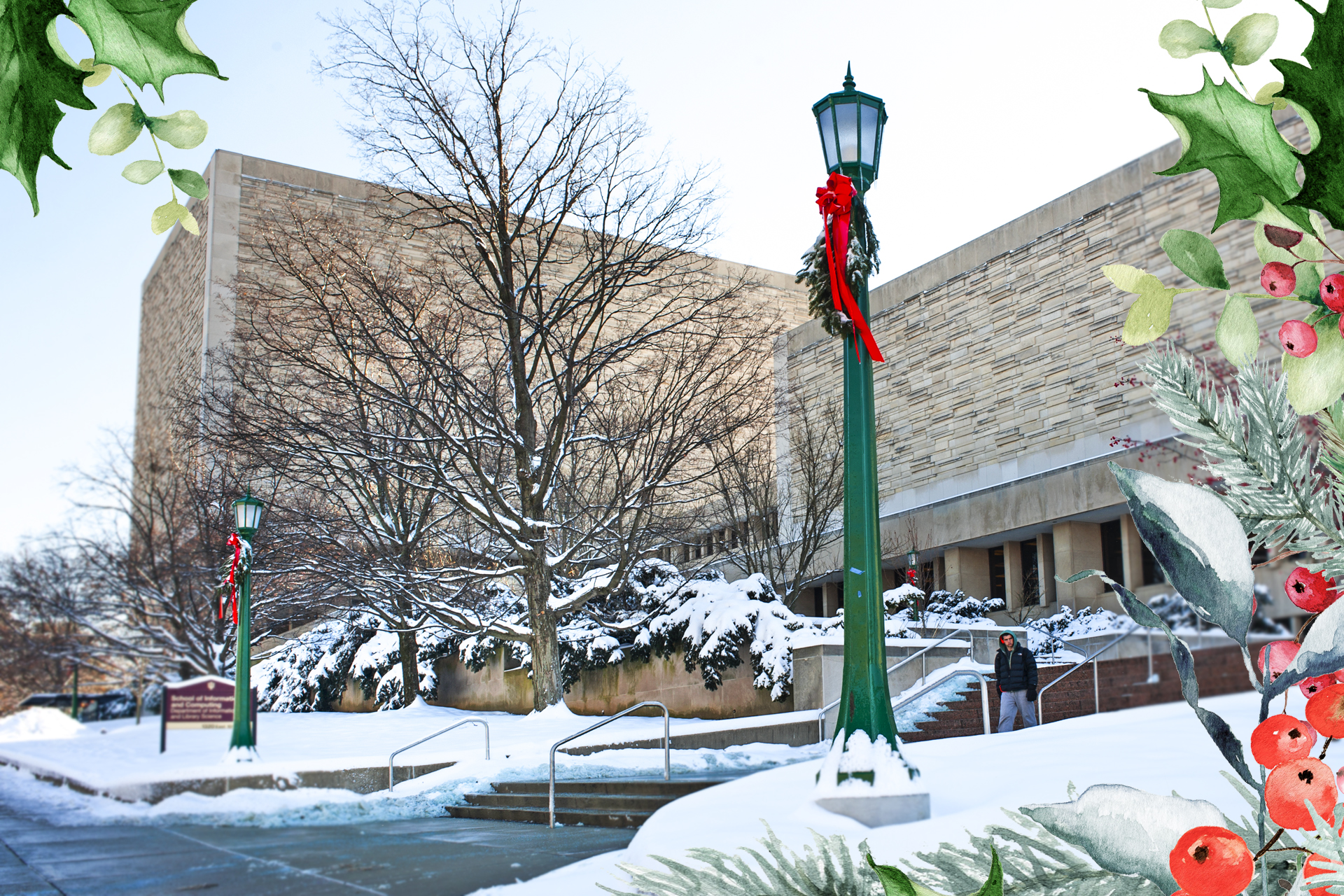 A festive frame of greenery is overlaid on a snowy photo of the Herman B Wells Library, as seen from 10th Street.