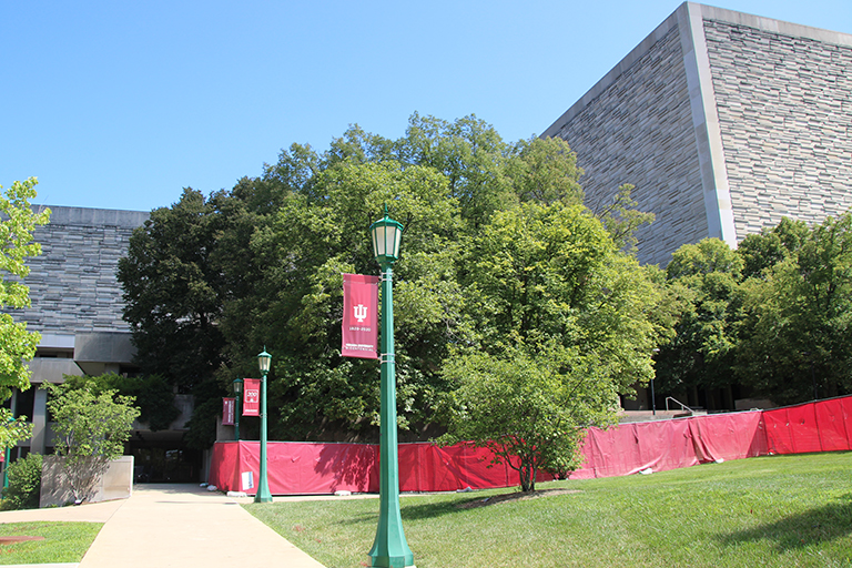 Wells Library is pictured with red fencing in place for upcoming construction