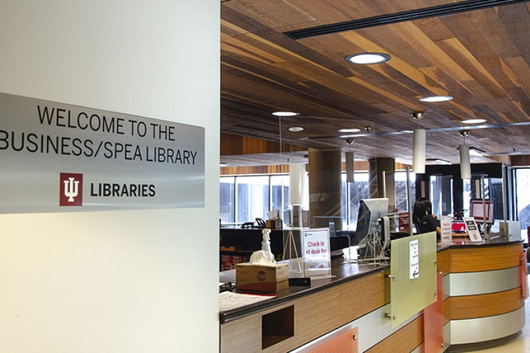 welcome to library sign and entrance business spea