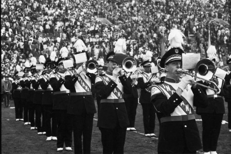 Image shows the Marching 100 playing on the field at the 1968 Rose Bowl parade.