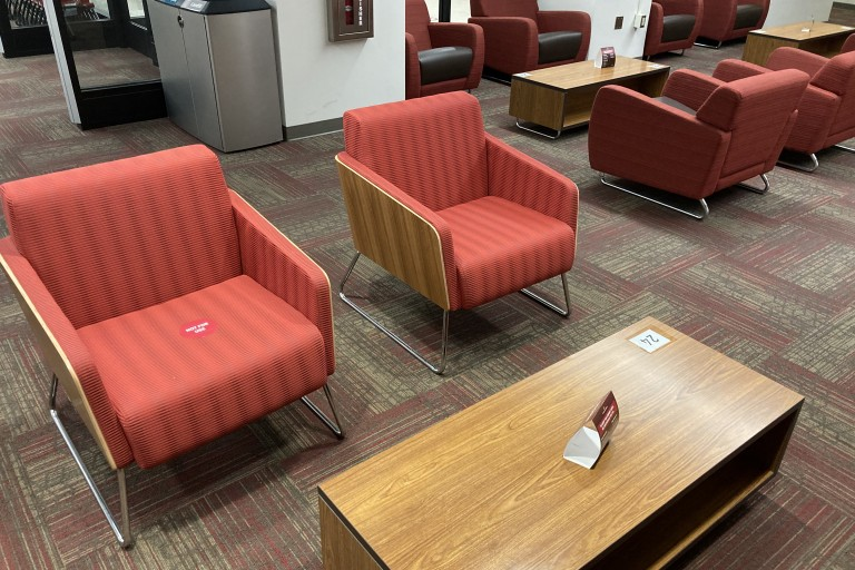 casual seating and coffee table in media services