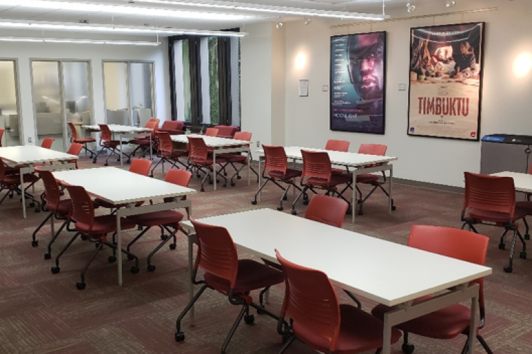 tabletop seating in media services with movie posters in the background