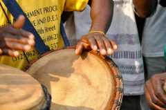 Men play drums at a health fair in Ghana